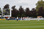 The players leave the field as rain stops play during the opening day of the Specsavers County Champ Div 1 match between Somerset County Cricket Club and Hampshire County Cricket Club at the Cooper Associates County Ground, Taunton, United Kingdom on 11 May 2018. Picture by Graham Hunt.