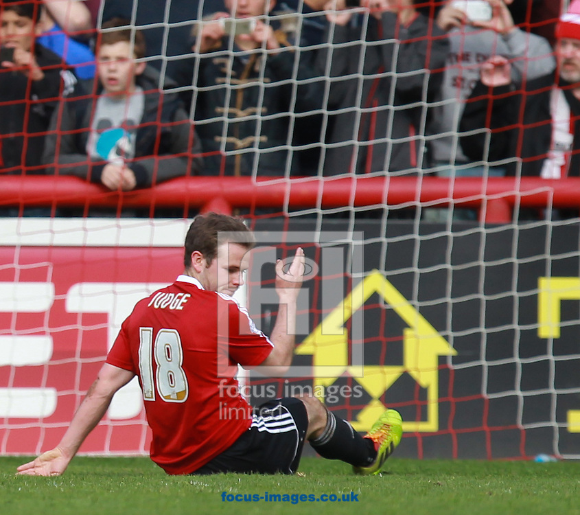 Alan Judge of Brentford looks at the penalty spot after slipping and sending his spot kick over the bar during the Sky Bet League 1 match at Griffin Park, London<br /> Picture by John Rainford/Focus Images Ltd +44 7506 538356<br /> 18/04/2014