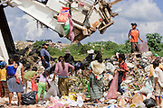 09 NOVEMBER 2004 - TAPACHULA, CHIAPAS, MEXICO: Garbage pickers, wait for a garbage truck from Tapachula to unload in the municipal garbage dump in Tapachula, Chiapas, Mexico. About 130 people, the poorest of the poor in Tapachula, work in the dump picking through the garbage hoping to find tidbits they can use or sell to brokers who sit on the edge of the dump and resell the garbage. Most of the dump workers are Guatemalan migrants who crossed the border hoping, at one time, to get to the United States. Now they have settled for an existence on the very edge of Mexican society. PHOTO BY JACK KURTZ