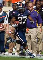 Virginia running back Cedric Peerman (37) en route to a 60 yard touchdown run.  The Virginia Cavaliers defeated the East Carolina Pirates 35-20 in NCAA football at Scott Stadium on the Grounds of the University of Virginia in Charlottesville, VA on October 11, 2008.