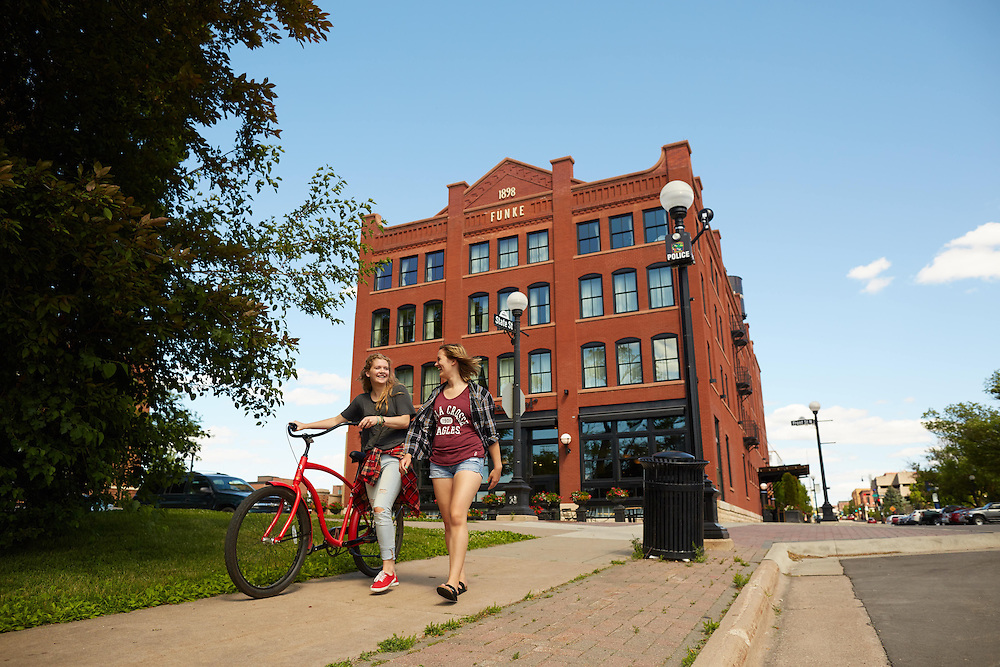 Activity; Socializing; Buildings; Downtown; Location; Outside; People; Woman Women; Man Men; Student Students; Summer; June; Time/Weather; day; Type of Photography; Candid; Lifestyle; UWL UW-L UW-La Crosse University of Wisconsin-La Crosse; Charmont Hotel; bike; Friends; Walking
