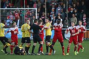 Players argue with Referee Andrew Laver during the National League South Play Off 1st Leg match between Whitehawk FC and Ebbsfleet United at the Enclosed Ground, Whitehawk, United Kingdom on 4 May 2016. Photo by Phil Duncan.