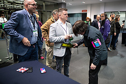 © Licensed to London News Pictures . 26/05/2019. Manchester, UK. STEPHEN YAXLEY-LENNON (aka Tommy Robinson ) is searched as he arrives . The count for seats in the constituency of North West England in the European Parliamentary election , at Manchester Central convention centre . Photo credit: Joel Goodman/LNP