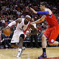 21 January 2012: Miami Heat small forward LeBron James (6) drives past Philadelphia Sixers center Nikola Vucevic (8) during the Miami Heat 113-92 victory over the Philadelphia Sixers at the AmericanAirlines Arena, Miami, Florida, USA.
