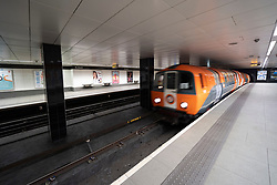 Glasgow, Scotland, UK. 1 April, 2020. Effects of Coronavirus lockdown on streets of Glasgow, Scotland. Nobody on platforms as Glasgow subway train pulls into St Enoch Station running a reduced service. Iain Masterton/Alamy Live News