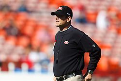 Oct 30, 2011; San Francisco, CA, USA; San Francisco 49ers head coach Jim Harbaugh watches his team warm up before the game against the Cleveland Browns at Candlestick Park. Mandatory Credit: Jason O. Watson-US PRESSWIRE