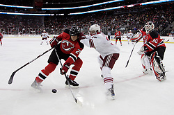 Mar 12, 2009; Newark, NJ, USA; New Jersey Devils goalie Martin Brodeur (30) plays the puck away from New Jersey Devils defenseman Johnny Oduya (29) and Phoenix Coyotes left wing Joakim Lindstrom (36) during the first period at the Prudential Center.