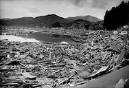 Flotsam from a town completely flattened by a massive tsunami that arrived 30 minutes after one of the biggest earthquakes in recorded history, Rikuzen-Takata, Iwate Prefecture, Japan.  In Rikuzen-Takata 10,547 residents, nearly half the population of roughly 26,000 people, are living in evacuation shelters.  Japan Self Defence Forces say they have found 300 to 400 bodies there. About 5,000 of the city's houses were submerged by the quake-triggered tsunami.