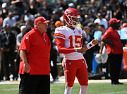 Sep 15, 2019; Oakland, CA, USA; Kansas City Chiefs head coach Andy Reid talks with quarterback Patrick Mahomes (15) before the game against the Oakland Raiders at Oakland-Alameda County Coliseum. The Chiefs defeated the Raiders 28-10..(Gerome Wright/Image of Sport)