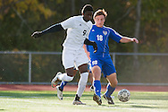 Burlington's Joel Atutor (9) and Mount Anthony's Isaac Salem (18) battle for the ball during the quarterfinal boys soccer game between Mount Anthony and Burlington at Buck Hard Field on Friday afternoon October 23, 2015 in Burlington. (BRIAN JENKINS/ for the FREE PRESS)