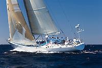 Crew sitting on sailboat on ocean
