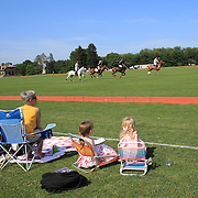 Spectators young and old watch the polo during the Airstream vs. Cinque Terre Polo match at the Greenwich Polo Club, Greenwich, Connecticut, USA. 23rd June 2013. Photo Tim Clayton