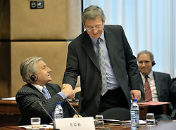 Jean-Claude Juncker, Luxembourg's prime minister and president of the Euro Group, right, greets Jean Claude Trichet, president of the European Central Bank, during a meeting on macro-economics, at the European Council headquarters, in Brussels, Belgium, Monday, Feb. 9, 2009. (Photo © Jock Fistick)