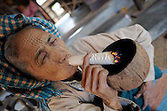 Burmese old woman smoking