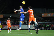 AFC Wimbledon midfielder Mitchell (Mitch) Pinnock (11) battles for possession with Blackpool defender Ben Heneghan (6) during the EFL Sky Bet League 1 match between AFC Wimbledon and Blackpool at the Cherry Red Records Stadium, Kingston, England on 29 December 2018.