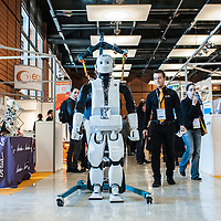 Lyon, France - 19 March 2014: REEM-C by PAL Robotics goes for a walk at Innorobo 2014, the 4th international trade show on service robotics.