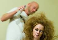9/20/08 Omaha, NEB.Christina Pierce gets her worked on by stylist Joe Novotny just before the fashion show as part of Omaha Fashion Week..Chris Machian/Omaha World-Herald.stage 3.dale heise slice