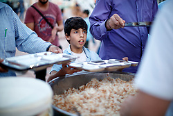 © Licensed to London News Pictures. 28/05/2017. Kırıkhan, TURKEY. A Syrian orphan queues to eat at an orphanage on the Turkish-Syrian border in Kırıkhan, near Antakya, Turkey on the first day of Ramadan during Former Minister of State for Faith and Communities, Baroness Warsi's visit. Photo credit: Tolga Akmen/LNP