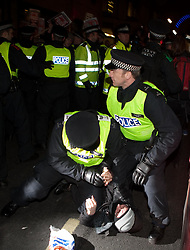 ©London News Picures. 2010.12.13 . Police arresting a protester who was making a gun guesture to police during a protest against increases in tuition fees and maintenance grant cuts in front of the  Department of Business, Innovation and Skills building in London. Photo credit should read Fuat Akyuz/London News Pictures.