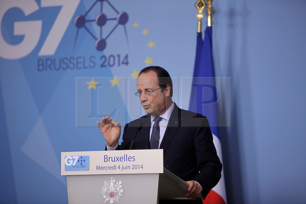 &copy; Licensed to London News Pictures. 04/06/2014. BRUSSELS, BELGIUM.<br /> Fran&ccedil;ois Hollande, French President, GIVES A PRESS CONFERENCE AT THE G7 SUMMIT IN BRUSSELS THIS EVENING AFTER THE WORKING DINNER WITH G7 LEADERS. Photo credit : RICH BOWEN/LNP