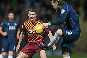 James Meredith (Bradford City) watches as Ben Coker (Southend United) clears the ball during the Sky Bet League 1 match between Bradford City and Southend United at the Coral Windows Stadium, Bradford, England on 16 February 2016. Photo by Mark P Doherty.