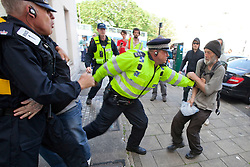 © Licensed to London News Pictures. 02/06/2012. Brighton, UK. Police push back a man opposed to the EDL and other nationalist groups in Brighton. Photo credit : Joel Goodman/LNP