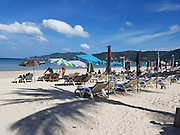 """Sunbed's are back  on Patong Beach as Patong Mayor confirms it bring happiness to tourists<br /> <br /> Sun loungers returned to Patong Beach under a new campaign driven by Patong Mayor Chalermluck Kebsup to """"bring happiness to Phuket tourists"""".  Workers started unloading the beach chairs and placing them inside the """"10% zones"""" at 11am, Mayor Chalermluck confirmed """"Yes, this is first day of beach chairs being brought back to Patong Beach. This has been approved by the Maj Gen Pornsak Poonsawat, Deputy Commander of Royal Thai Army Region 4,"""" Mayor Chalermluck said.<br /> The Army Region 4 base in Nakhon Sri Thammarat is the military unit responsible for all of Southern Thailand.<br /> <br /> Gen Pornsak, who last conducted inspection visit to Patong Beach on Feb 10 , was back on Patong Beach to oversee the beach chair restoration in person, Mayor Chalermluck added.<br /> <br /> """"At first, we set out the beach chairs at 11am as a trial, but the tourists saw them and appreciated them and were happy, and they started to sit down using the beach chairs,"""" she explained. """"Gen Pornsak saw the good feedback from tourists himself, so I asked him to allow beach chairs to stay on the beach, not just for a trial – and he approved it,"""" Mayor Chalerluck said.<br /> <br /> """"This will help tourists to be no longer confused about why sun loungers are not allowed on the beach, and will make it more comfortable for elderly tourists who want to enjoy sitting on the beach,"""" she added.<br /> <br /> However, the use of sun loungers on the beach is restricted to the """"10% zones"""", which are the only areas on the sand where vendors may provide services, Mayor Chalermluck explained.""""In Patong, There is five 10% zones, with 180 umbrellas and 360 beach chairs in each zone,"""" she added.<br /> <br /> """"Beach chair rental prices are limited to not more than B200 per a chair,"""" she said.<br /> <br /> """"This is in line with the original policy set out in 2014, which allowed beach chairs in the 10% zones o"""