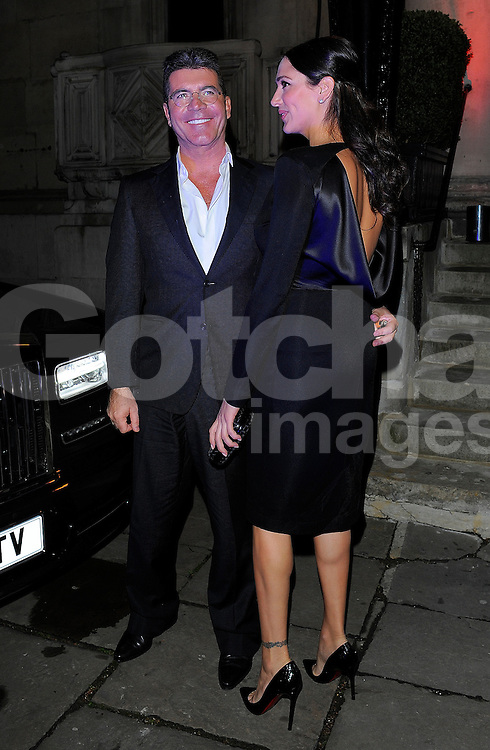 Simon Cowell and Lauren Silverman at the I Can't Sing opening night party held at One Marylebone in London, UK. 26/03/2014<br />BYLINE MUST READ : GOTCHAIMAGES.COM<br /><br />Copyright by &copy; Gotcha Images Ltd. All rights reserved.<br />Usage of this image is conditional upon the acceptance <br />of Gotcha Images Ltd, terms and conditions available at<br />www.gotchaimages.com