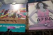 A couple walks by billboards advertising family planning methods in Addis Ababa, Ethiopia, November 16, 2013.