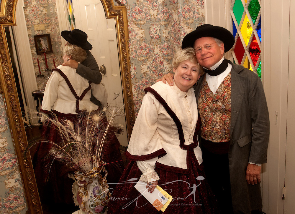 Homeowners Sid and Brenda Caradine, dressed in period costume, pose for a picture at the Amzi Love Home in Columbus, Miss. April 17, 2010. The 1848 home, which has been featured in Fodor's Travel Guide and The New York Times Travel Magazine, was among nearly two dozen on tour during Columbus' annual Spring Pilgrimage. (Photo by Carmen K. Sisson/Cloudybright)