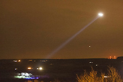 Police helicopter helps police on the ground to searches an area close to High Bonnybridge, last night 23/1/2012..Pic © Michael Schofield...