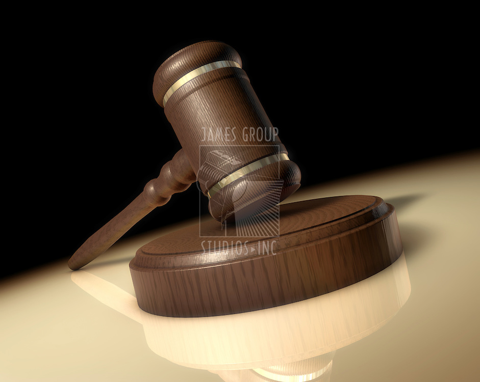 A Judge's gavel worm's-eye view from desk in a spotlight