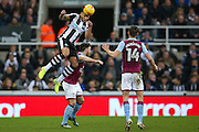 Newcastle United defender Jamaal Lascelles (6) meets the ball during the EFL Sky Bet Championship match between Newcastle United and Aston Villa at St. James's Park, Newcastle, England on 20 February 2017. Photo by Simon Davies.