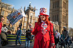 © Licensed to London News Pictures. 29/03/2019. London, UK. A Brexit supporter in fancy dress waves a flag outside Parliament during a Leave Means Leave rally. MPs have voted to reject Prime Minister Theresa May's withdrawal agreement for a third time today. Photo credit: Rob Pinney/LNP