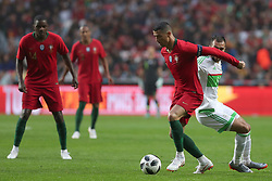 June 7, 2018 - Lisbon, Portugal - Portugal's forward Cristiano Ronaldo (C ) vies with AlgeriaÂ«s defender Salim Boukhanchouche during the FIFA World Cup Russia 2018 preparation football match Portugal vs Algeria, at the Luz stadium in Lisbon, Portugal, on June 7, 2018. (Credit Image: © Pedro Fiuza via ZUMA Wire)