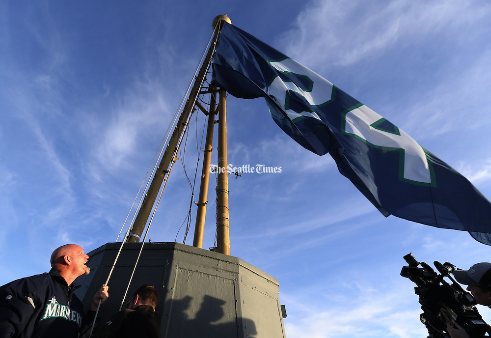 Mariners great Jay Buhner raises a No. 24 flag atop the Space Needle against a blue Seattle sky in honor of teammate Ken Griffey Jr.&rsquo;s election Wednesday to the National Baseball Hall of Fame. <br />