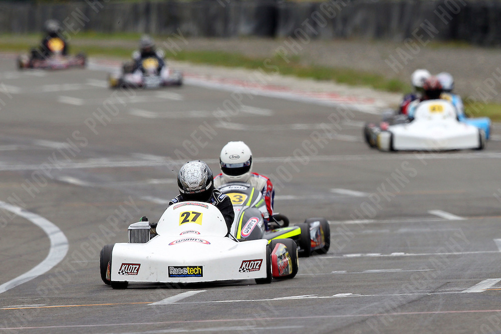 Andrew Hoare, 27, and Mason Armstrong, 63, race in the Rotax Light class during the 2012 Superkart National Champs and Grand Prix at Manfeild in Feilding, New Zealand on Saturday, 7 January 2011. Credit: Hagen Hopkins.