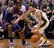 Utah Jazz point guard Deron Williams, right, is pressured by New York Knicks power forward Amar'e Stoudemire (1) during the first half of an NBA basketball game in Salt Lake City, Wednesday Jan. 12, 2011. (AP Photo/Colin E Braley)