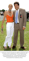 TV presenter TANIA BRYER and her husband TIM MOUFFARIGE, at a polo match in Berkshire on 28th July 2002.PCL 248