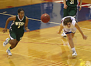 West's Shahana Williams (1) and Washington's Danielle Franklin (32) scramble for a lose ball during the girl's high school basketball game between Iowa City West and Cedar Rapids Washington at Washington High School, 2205 Forest Drive SE, in Cedar Rapids, on Tuesday evening, January 3, 2012. (Stephen Mally/Freelance)