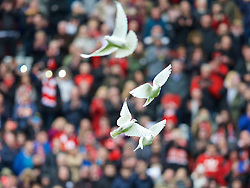 LIVERPOOL, ENGLAND - Friday, April 15, 2016: Family members of the 96 victims release white doves after the 27th Anniversary Hillsborough Service at Anfield. (Pic by David Rawcliffe/Propaganda)