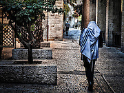 Jewish man wrapped in a tallith in the Jewish Quarter, Old City, Jerusalem