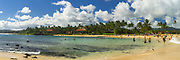 Tourists enjoy their fun at Poipu Beach, Koloa, Kauai, Hawaii, USA.