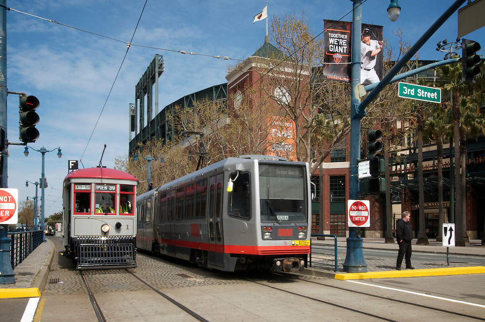 Streetcar 1 sits along side one of it's modern day counterparts, a Muni LRV, in front of AT&T Park