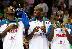 Players of France celebrate at medal ceremony after the final basketball game between National basketball teams of Spain and France at FIBA Europe Eurobasket Lithuania 2011, on September 18, 2011, in Arena Zalgirio, Kaunas, Lithuania. Spain defeated France 98-85 and became European Champion 2011, France placed second and Russia third. (Photo by Vid Ponikvar / Sportida)