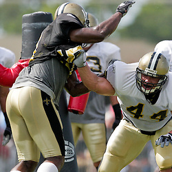 04 August 2009:Llinebacker Jonathan Vilma (51) gets past fullback Heath Evans (44) on a pass protection drill during New Orleans Saints training camp at the team's practice facility in Metairie, Louisiana.