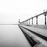 Michigan City lighthouse black and white picture. The Michigan City East Pierhead Lighthouse is located in Michigan City, Indiana along the Lake Michigan shoreline.