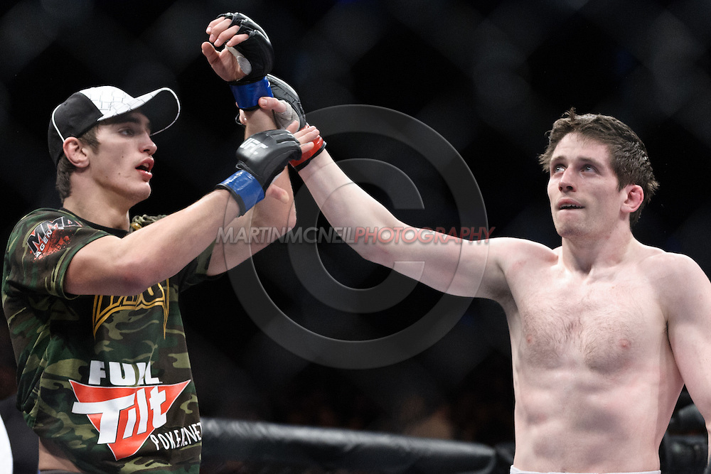 "DUBLIN, IRELAND, JANUARY 17, 2009: John Hathaway (left) raises the hand of Tom Egan in a gesture of good sportsmanship after Hathaway defeated Egan during their fight at ""UFC 93: Franklin vs. Henderson"" inside the O2 Arena in Dublin, Ireland"