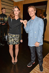 ALFIE ALLEN and SAI BENNETT at the Louis Vuitton for Unicef Event #MAKEAPROMISE held at The Apartment, 17-20 New Bond Street, London on 14th January 2016.