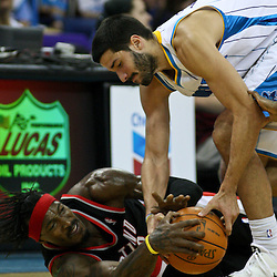 January 16, 2012; New Orleans, LA, USA; New Orleans Hornets point guard Greivis Vasquez (21) and Portland Trail Blazers small forward Gerald Wallace (3) scramble for a loose ball during the second half of a game at the New Orleans Arena. The Trail Blazers defeated the Hornets 84-77.  Mandatory Credit: Derick E. Hingle-US PRESSWIRE